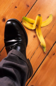 businessman-about-to-step-on-banana-skin